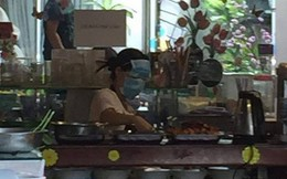Cô bán canteen chiên cá theo style ninja: Bịt hẳn 2 cái khẩu trang kín mít!
