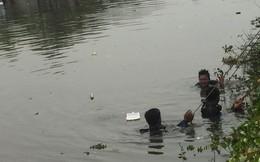 Phơi nắng suốt nhiều giờ theo dõi người nhái lặn tìm người đàn ông nhảy kênh tự tử