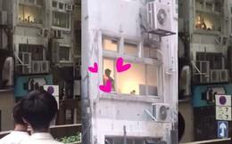 """Hong Kong: Người dân tụ tập dưới sân chung cư xem """"phim tình cảm"""" miễn phí"""