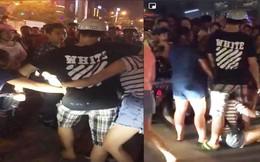 Đang bế con nhỏ bắt gặp chồng đi với người phụ nữ khác, vợ lao vào đánh ghen