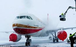 24h qua ảnh: Máy bay đóng băng trên sân bay Trung Quốc