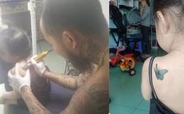 Hình ảnh người bố xăm hình con bướm vào lưng con gái nhỏ tuổi và sự thật