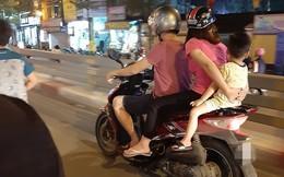 Cả gia đình di chuyển bằng xe máy trên phố Hà Nội - bức ảnh nhận nhiều dấu hỏi nhất tối Chủ nhật