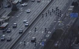 Đoàn xe ông Kim Jong-un được hộ tống hùng hậu trên đường phố Bắc Kinh
