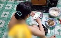 Bức ảnh cô gái khỏa thân ngồi ăn cơm cho tiết kiệm điện dưới tiết trời nắng nóng 40 độ gây sốc, một chi tiết bị soi nhiều nhất