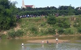 Hai cha con đuối nước tử vong khi đi cào hến trên sông
