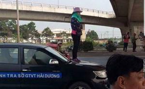 Người phụ nữ đứng lên nắp capo xe Thanh tra giao thông để phản đối dẹp vỉa hè