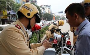 Bằng lái, đăng ký xe photo công chứng có giá trị khi cảnh sát giao thông kiểm tra không?