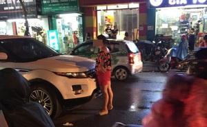 Xôn xao clip vợ bế con chặn trước đầu ô tô, bắt gặp chồng ngoại tình giữa phố Hà Nội