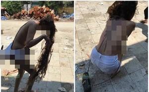 Hình ảnh cô gái bị lột đồ, đổ mắm tôm, dầu luyn khắp người và dòng chia sẻ ngắn gây sốt