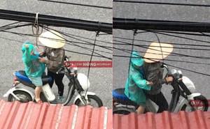 Hình ảnh người mẹ đội nón lá dừng xe giữa đường mặc áo mưa cho con trai gây xúc động