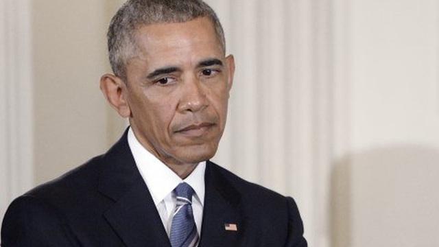 """Đêm """"đáng sợ nhất"""" của Obama và ý tưởng đồng xu nghìn tỷ USD"""