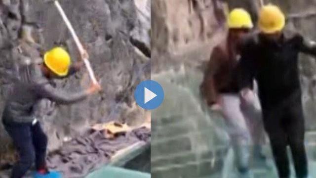 Công việc nguy hiểm: Dùng búa tạ đập mặt cầu kính ở độ cao gần 200m