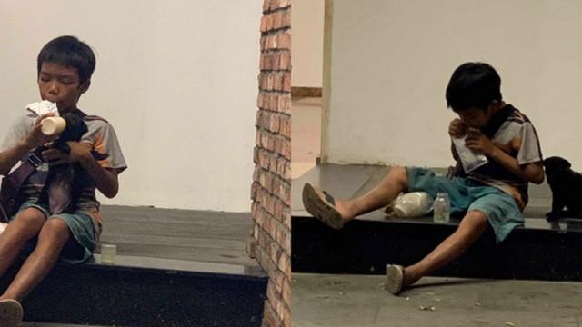 Cậu bé bán vé số chia đôi hộp sữa cho chú chó: Tiết lộ khoảnh khắc gặp gỡ đầy xúc động