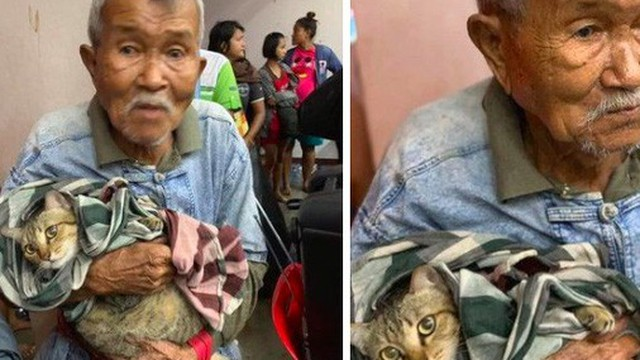 Cụ ông gây xúc động khi ôm khư khư chú mèo cưng đi tránh cơn bão lớn nhất 3 thập kỷ ở Thái Lan