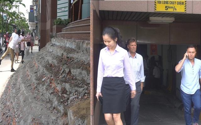 Nhân viên chui hầm sau khi tòa nhà bị phá dỡ bậc tam cấp lấn chiếm vỉa hè