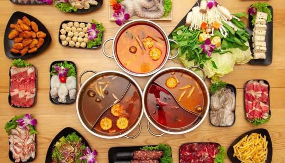 Hàng buffet lẩu ở Hà Nội tung chiêu: Giảm giá theo độ lùn của khách - Ảnh 1.