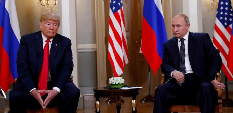 16 khoảnh khắc đáng nhớ trong nhiệm kỳ đầu tiên của Tổng thống Donald Trump qua ảnh Reuters - Ảnh 9.