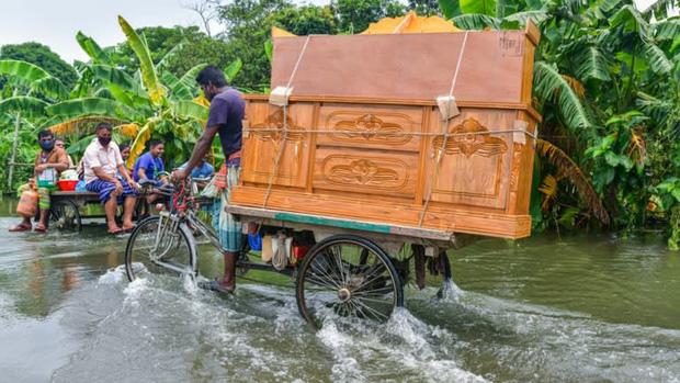 Mưa lũ bất thường gia tăng liên tiếp tại châu Á vì biến đổi khí hậu - Ảnh 1.