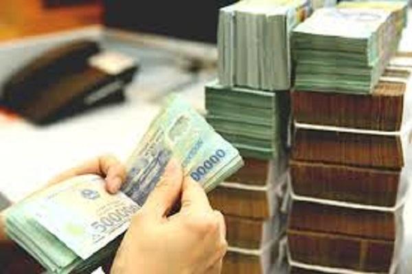 Ngân hàng rục rịch hạ lãi suất cho vay kinh doanh - Ảnh 1.