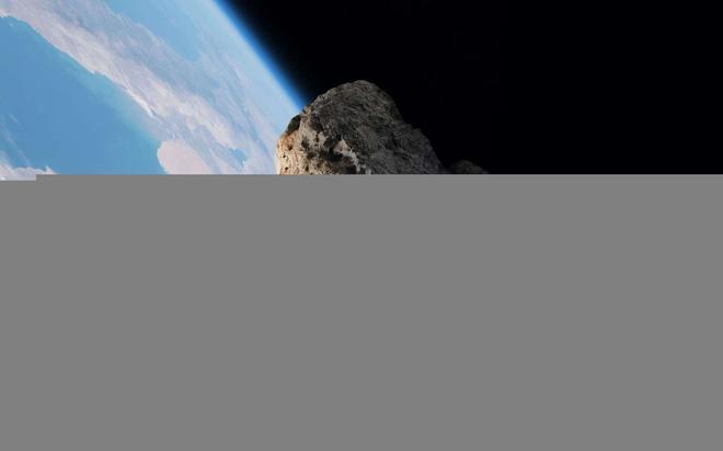 Một thiên thạch vừa suýt lao vào Trái đất ở khoảng cách gần kỷ lục mà không ai hay biết - Ảnh 1.
