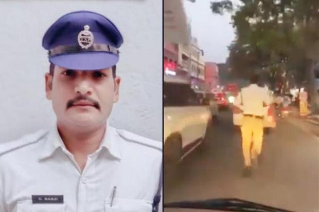 Ấn Độ: Tan chảy trước anh cảnh sát chạy bộ 2 km mở đường cho xe cấp cứu - Ảnh 1.