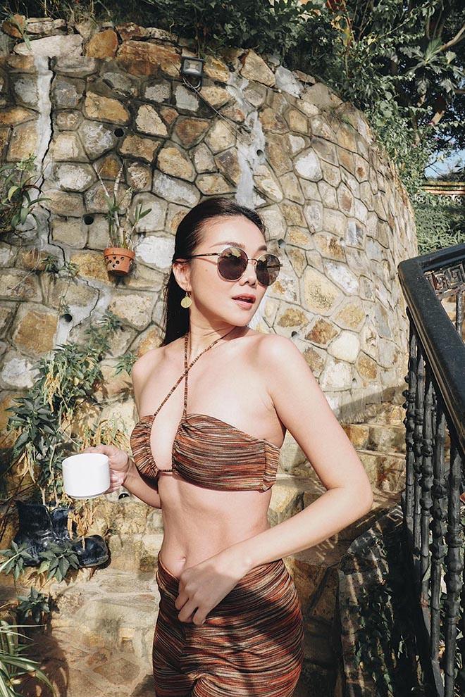 Siêu mẫu Thanh Hằng ở tuổi 37: Chưa lấy chồng, chăm khoe ảnh nóng bỏng - Ảnh 13.