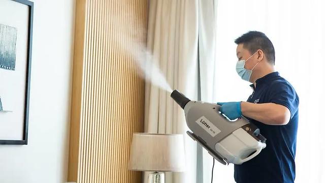 """Robot lao công - Xu hướng """"bình thường mới"""" trong du lịch hậu COVID-19 tại Singapore - Ảnh 2."""