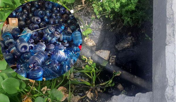 Lấy trực tiếp nước từ mương nước thải sinh hoạt để sản xuất nước uống đóng bình - Ảnh 2.