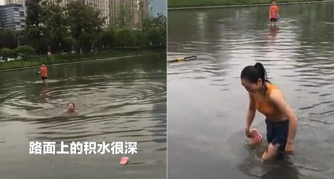 Cô gái Trung Quốc điềm nhiên bơi qua con phố ngập vì sợ đi làm muộn - Ảnh 2.