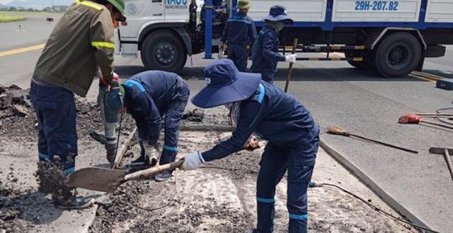 Giám sát viên biến mất, đài không lưu không gọi được công nhân sửa đường lăn sân bay Nội Bài - Ảnh 1.
