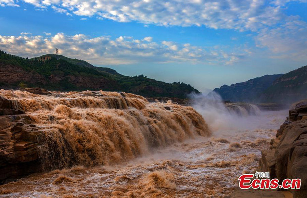 Chùm ảnh: Lũ lụt nghiêm trọng tại Trung Quốc, hơn 12 triệu người bị ảnh hưởng - Ảnh 12.