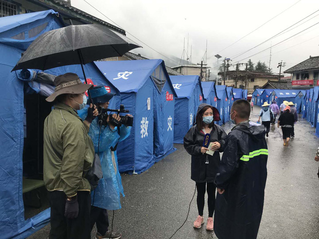 Chùm ảnh: Lũ lụt nghiêm trọng tại Trung Quốc, hơn 12 triệu người bị ảnh hưởng - Ảnh 4.