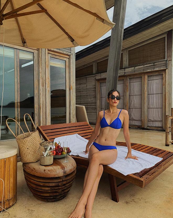 Hoa hậu Trần Tiểu Vy tung ảnh mặc bikini táo bạo - Ảnh 2.