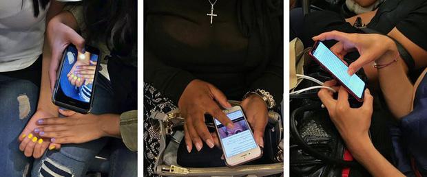 Vì sao chúng ta luôn vô thức nhìn vào màn hình điện thoại của người khác? - Ảnh 1.