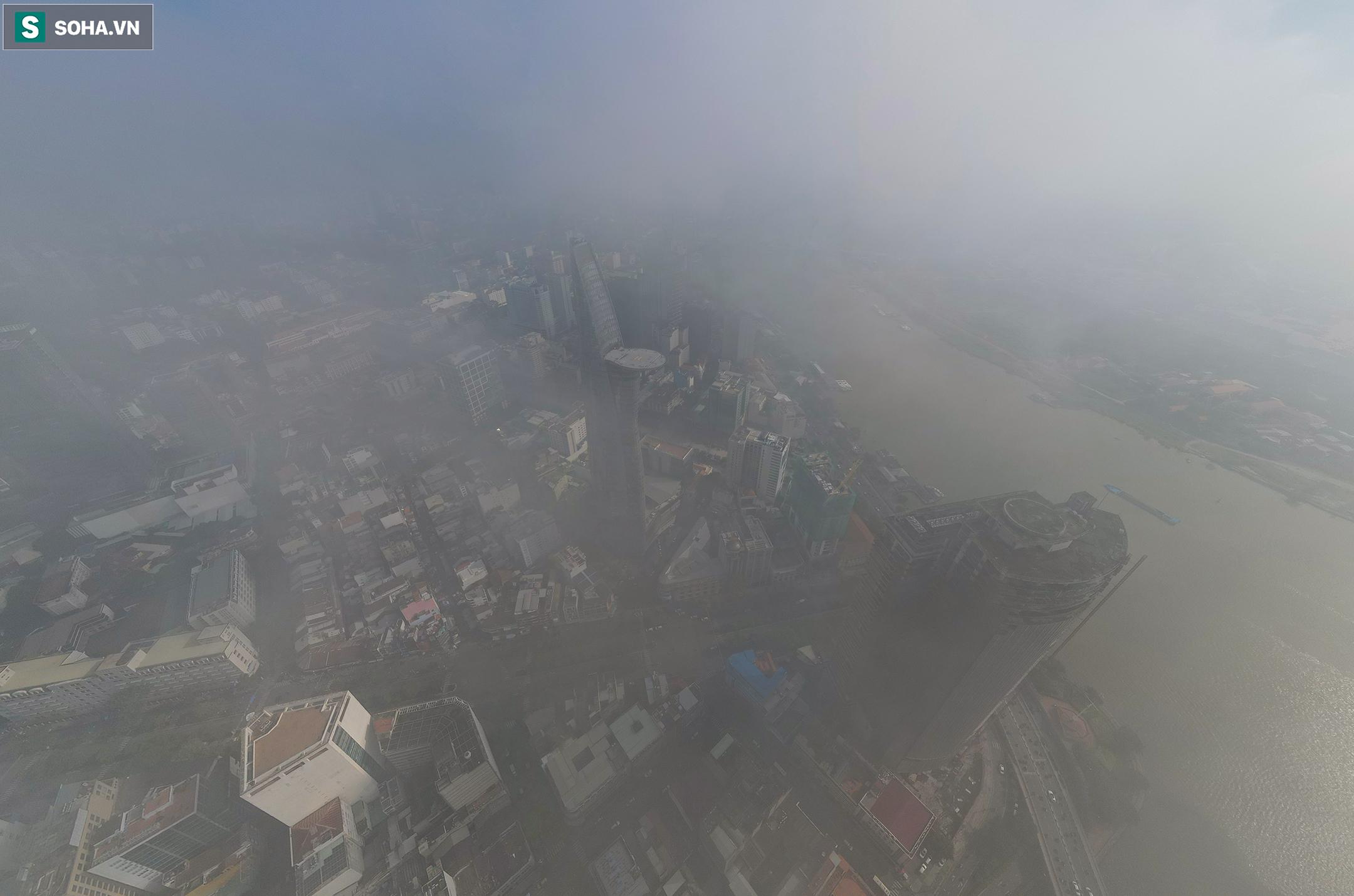 [Ảnh] Chất lượng không khí báo động đỏ, nhiều toà cao ốc ở TP.HCM bất ngờ biến mất trong sáng đầu tuần - Ảnh 10.