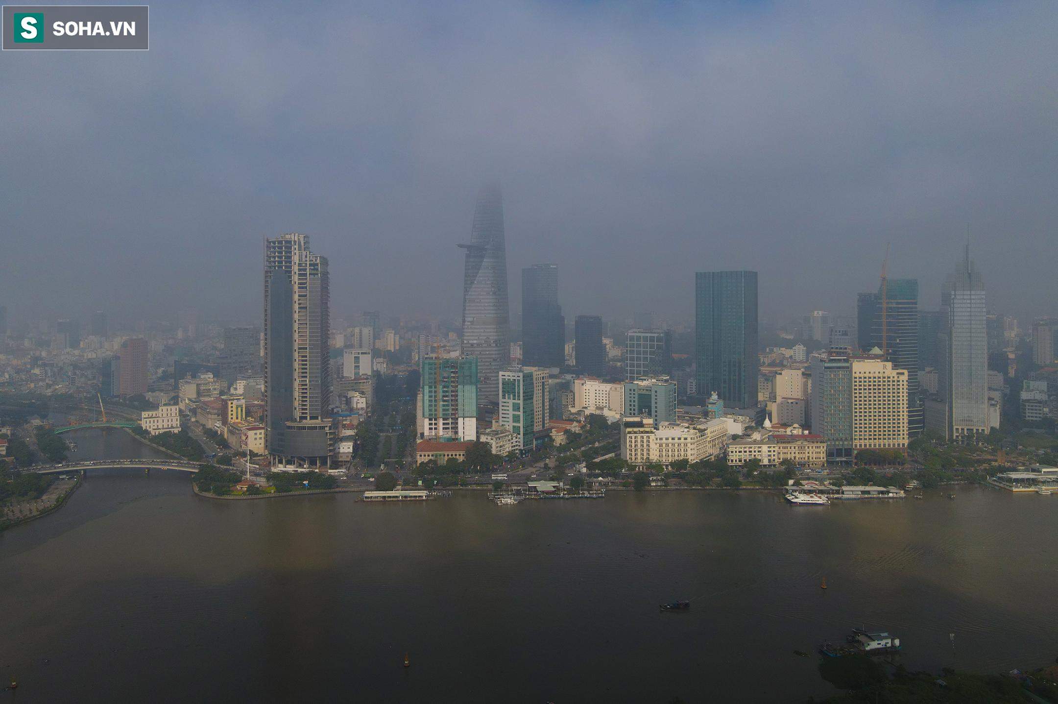 [Ảnh] Chất lượng không khí báo động đỏ, nhiều toà cao ốc ở TP.HCM bất ngờ biến mất trong sáng đầu tuần - Ảnh 1.
