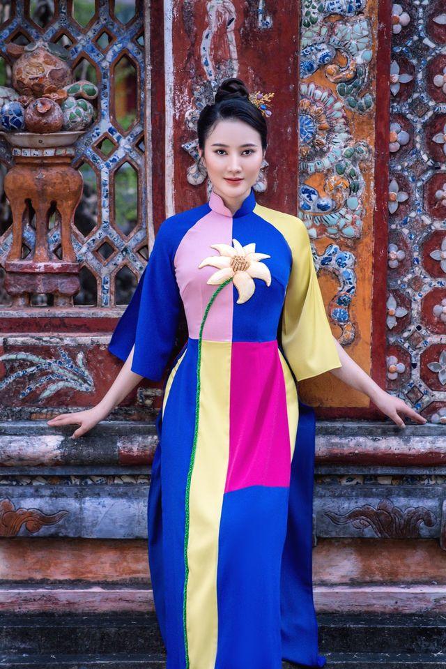 Mỹ nhân có mái tóc đẹp nhất Hoa hậu Việt Nam 2016 duyên dáng trong tà áo dài - Ảnh 2.