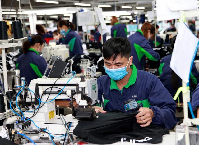Tăng lương tối thiểu trong năm 2021 là rủi ro với doanh nghiệp? - Ảnh 2.