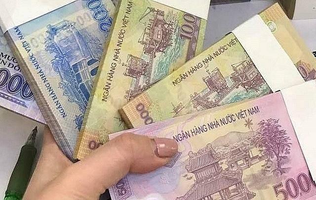 Phạt nặng việc đổi tiền lẻ kiếm lời dịp Tết Nguyên đán Tân Sửu 2021 - Ảnh 2.