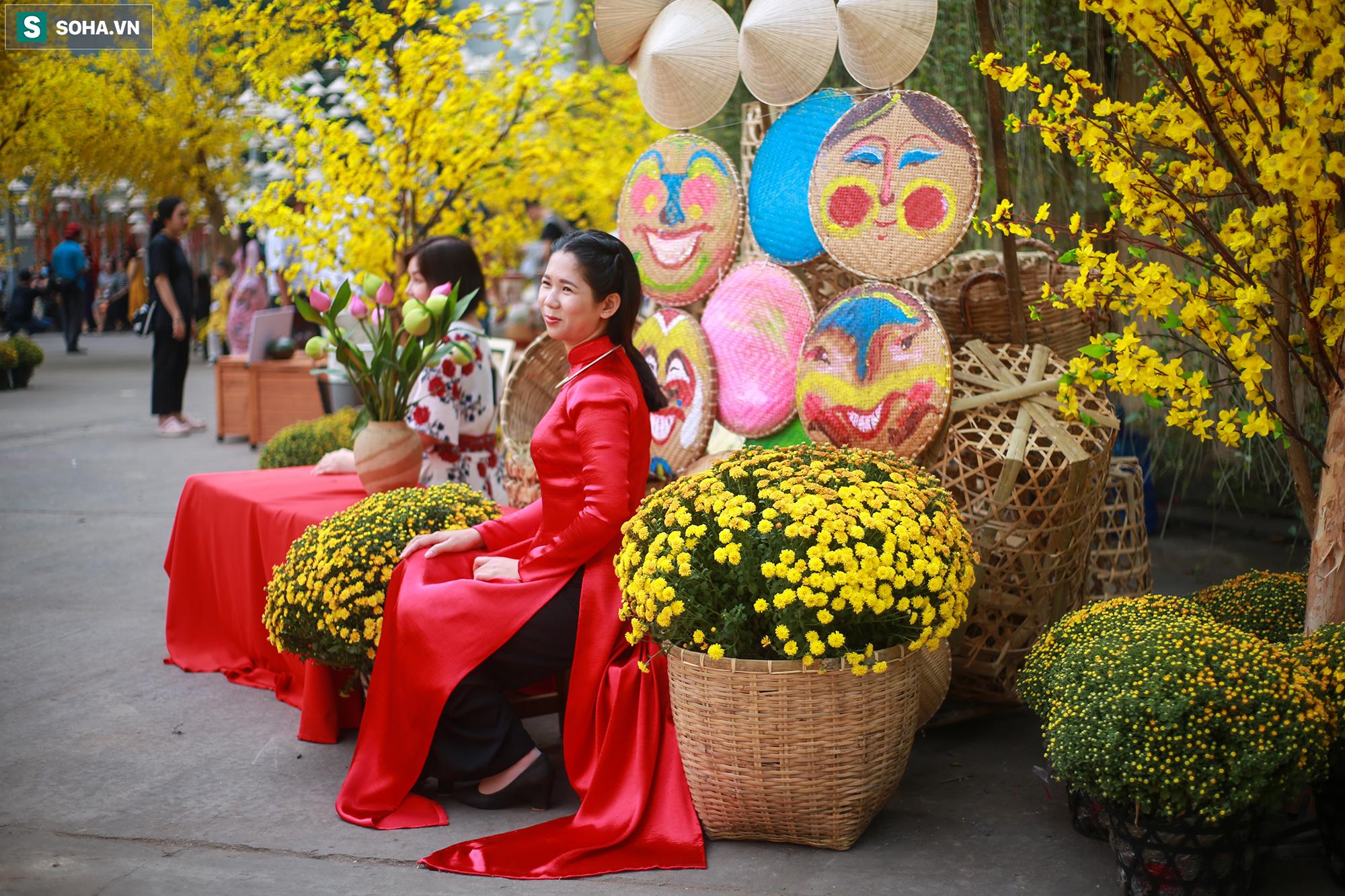 [Ảnh] Thiếu nữ Sài Gòn xinh đẹp xúng xính áo dài check-in sống ảo ở con đường hoa mai - Ảnh 10.