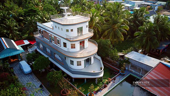 Một nông dân làm nghề nuôi lươn ở Vĩnh Long bỏ 5 tỷ xây căn nhà có hình dáng lạ - Ảnh 1.