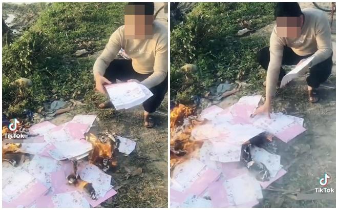 Phát hiện bạn gái có bầu với người khác, chàng trai đốt hàng trăm tấm thiệp cưới ở bãi rác - Ảnh 1.