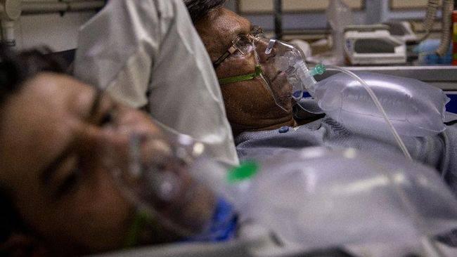 Bệnh nhân Covid-19 ở Ấn Độ xuất hiện thêm các triệu chứng mới: Chảy máu mũi - miệng, lú lẫn - Ảnh 1.