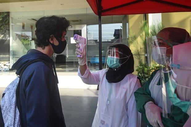 Lại thêm một quốc gia ở Châu Á oằn mình chống dịch Covid-19: Xác nhận có 8276 ca nhiễm/ngày - Ảnh 1.
