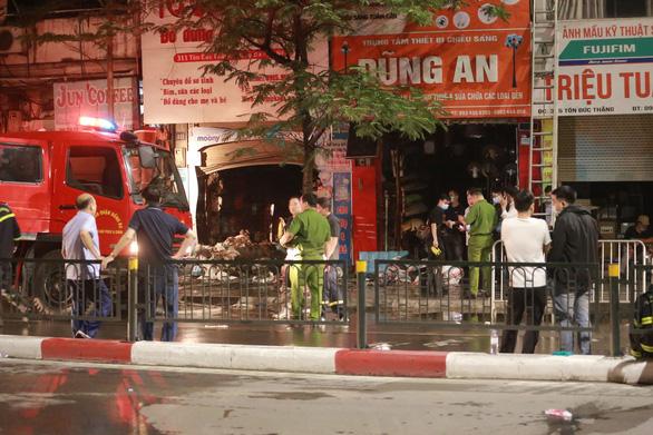 [ẢNH] Hiện trường vụ cháy cửa hàng bán đồ trẻ em khiến 4 người trong gia đình tử vong - Ảnh 14.