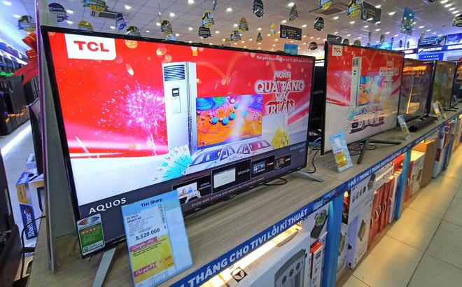 Tivi giảm giá 50%, mẫu 75 inch tràn viền bán rẻ - Ảnh 1.
