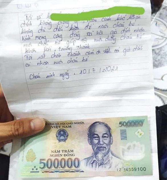 Thái Bình: Bé trai bị bỏ rơi trong đêm gần nghĩa trang kèm theo lá thư và tờ tiền 500.000 đồng - Ảnh 1.