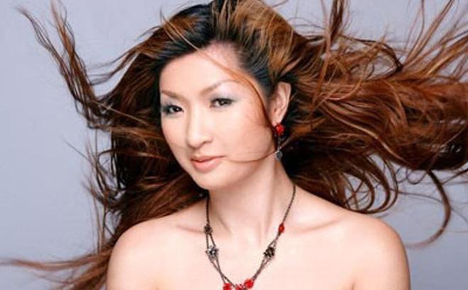 Nhan sắc thời trẻ của Nguyễn Hồng Nhung - nữ ca sĩ khổ sở vì scandal lộ clip nóng - Ảnh 3.