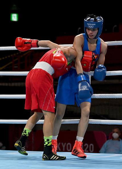 Võ sĩ Việt Nam chơi quả cảm ở Olympic, suýt tạo nên bất ngờ trước á quân thế giới - Ảnh 1.